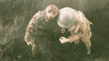 Screen shot of the mannequin-soldier being pulled out of the muddy shell crater.