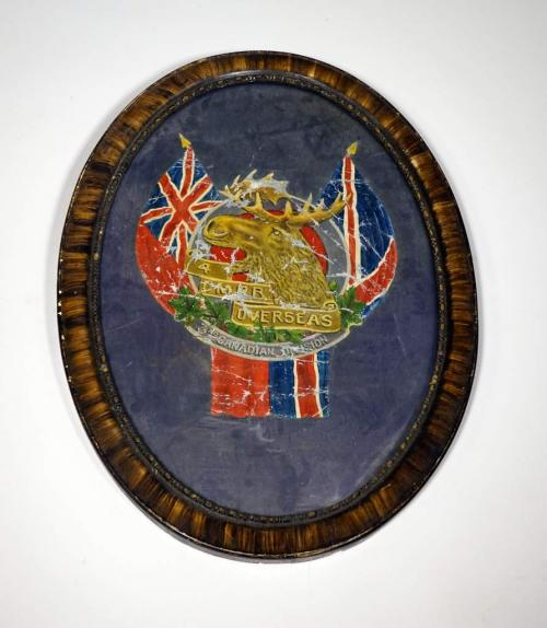 An oval, framed picture with a moose head with Union Jack imagery.