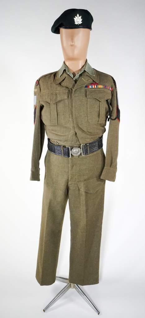 A mannequin wearing a WWII soldier's uniform with the insignia of the  Queen's Own Rifles.