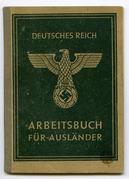 A small, softcover green booklet with the German eagle on top of a swastika  symbol on the cover.