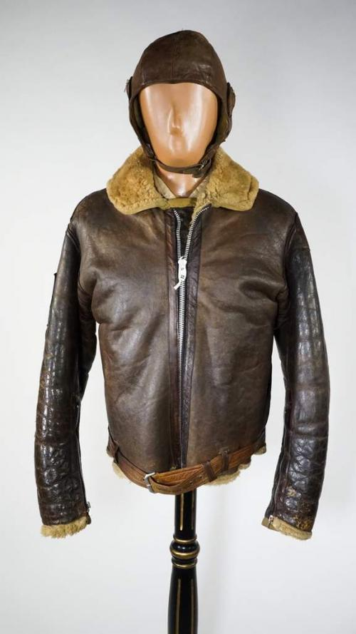 A brown leather bomber jacket with a thick lining.
