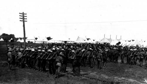 A black and white photograph of a group of soldiers forming up into rows  during training.