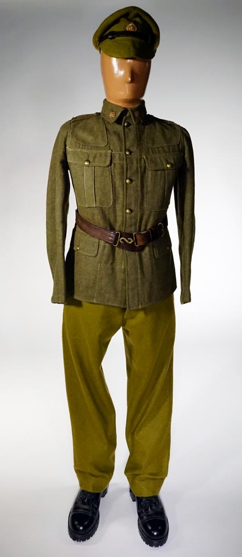 A mannequin wearing a soldier's green khaki cap and an  undecorated tunic.