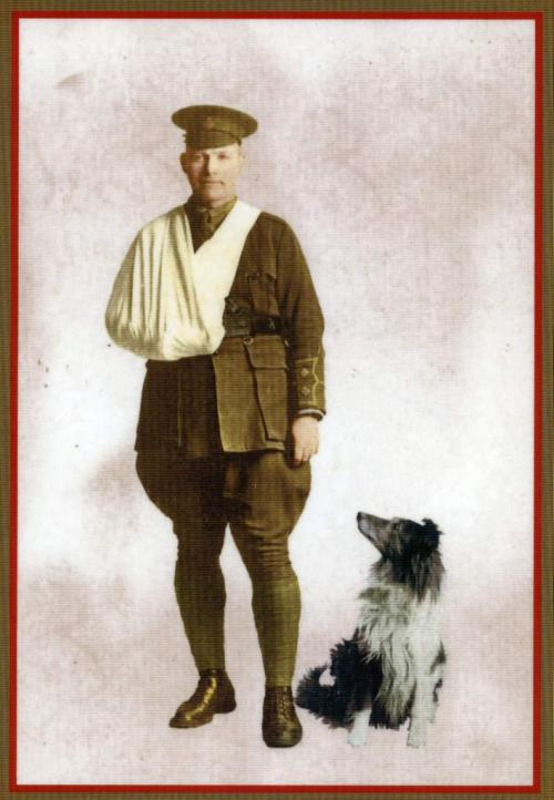 A black-and-white photograph of a wounded Lieutenant Jack Munroe with his dog