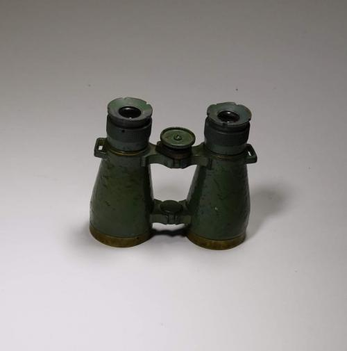 A pair of green metal binoculars.