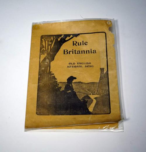 "A folded, over-sized song sheet with the music for the song ""Rule Britannia."""