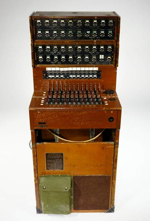 A portable switchboard in a fold-up wooden case.