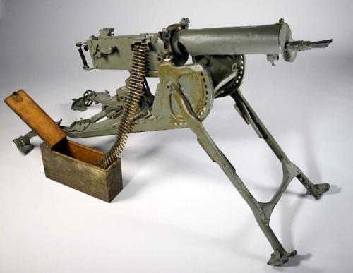 An image of an ammunitions belt  partially loaded into a large machine gun.