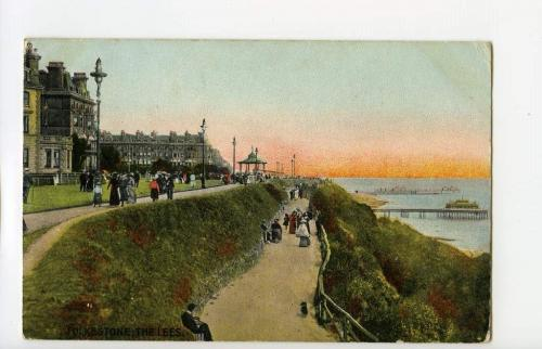 A colourized postcard depicting the harbour of the seaside town of Folkestone, England.