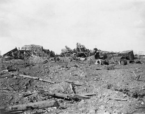 Alt text: A black-and-white photograph of a war-ravaged landscape
