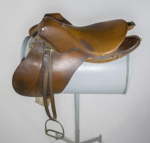 An English-style, brown leather saddle.