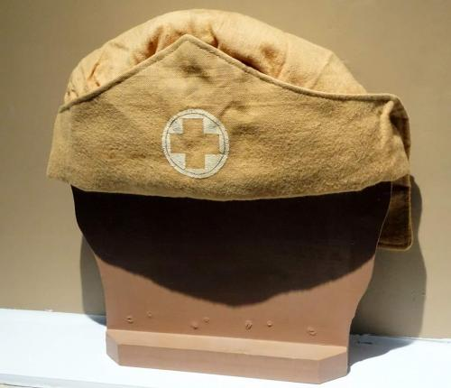 A tan-coloured, soft nurse's cap.