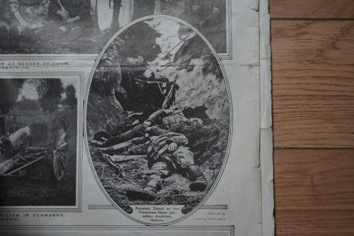 A black-and-white newspaper photograph of several dead Russian soldiers lying in a trench.