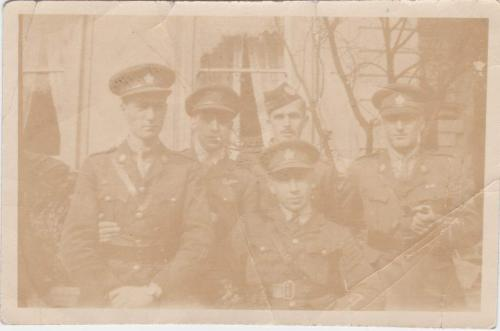 A sepia-toned photograph of Byron Cooper Sisler posing with soldiers from his  Air Force class.