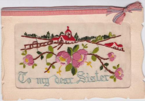 "A cloth postcard depicting an embroidered church and house, reading ""To my dear Sister."""