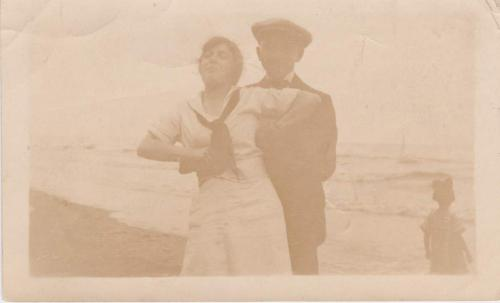 A sepia-toned image of Byron Cooper Sisler with Mildred Ramsden at a  beach.