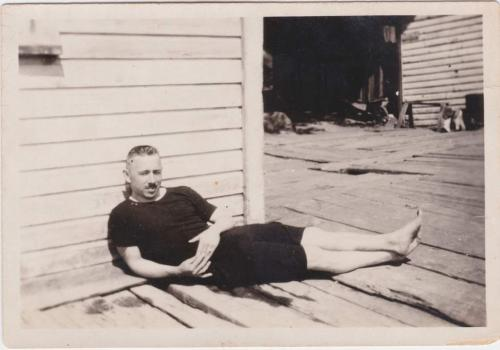 A black-and-white photograph of Byron Cooper Sisler relaxing.