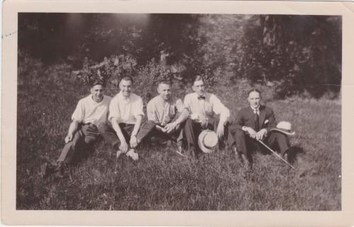A black-and-white photograph of Byron Cooper Sisler sitting with a group of friends.