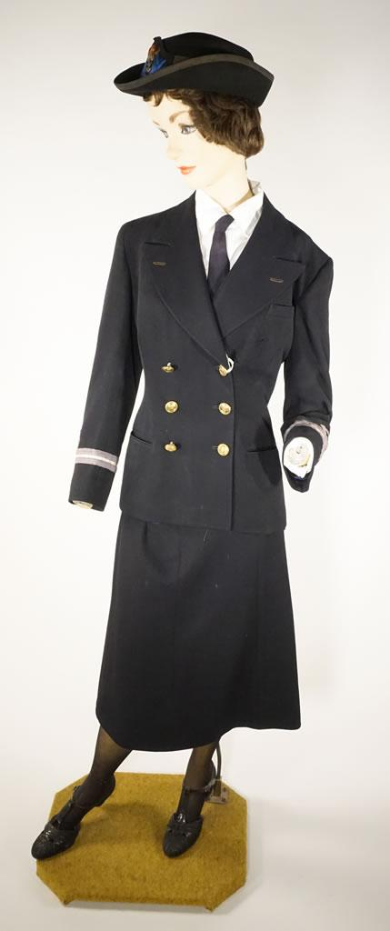 A navy blue uniform consisting of a fitted jacket and knee-length skirt.
