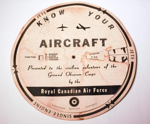 A cardboard wheel that spins to line-up the silhouettes of various aircraft  with their name.