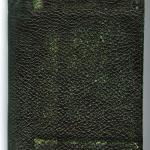 A small, black leather bound book used as wartime diary.