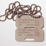Rectangular metal dog tags.