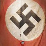 A classic red Nazi flag with the white circle with a black swastika in the center.